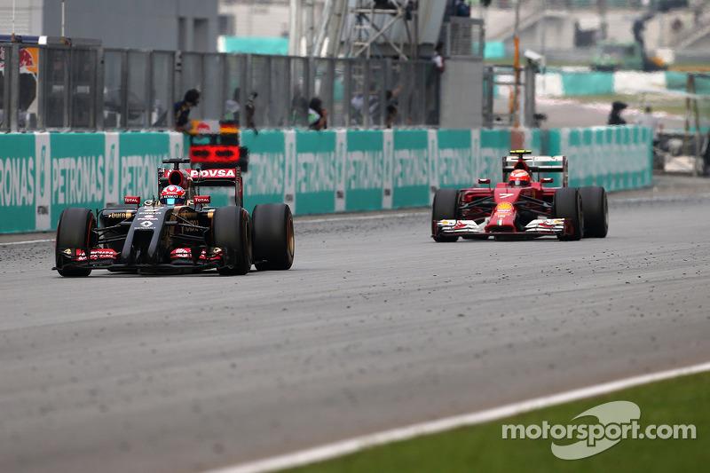 Romain Grosjean (FRA), Lotus F1 Team; Kimi Raikkonen (FIN), Scuderia Ferrari  30