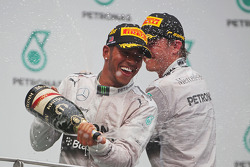 Race winner Lewis Hamilton, Mercedes AMG F1 celebrates on the podium with second placed team mate Nico Rosberg, Mercedes AMG F1