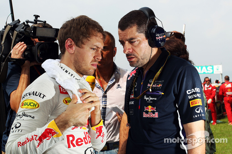 (L to R): Sebastian Vettel, Red Bull Racing with Guillaume Rocquelin, Red Bull Racing Race Engineer