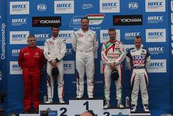 1st position Yvan Muller, Citroen C-Elysee WTCC, Citroen Total WTCC, 2nd position Jose Maria Lopez, Citroen C-Elysee WTCC, Citroen Total WTCC, 3rd position Tiago Monteiro, Honda Civic WTCC, Castrol Honda WTCC Team and 1st position Yokohama Trophy Pasquale