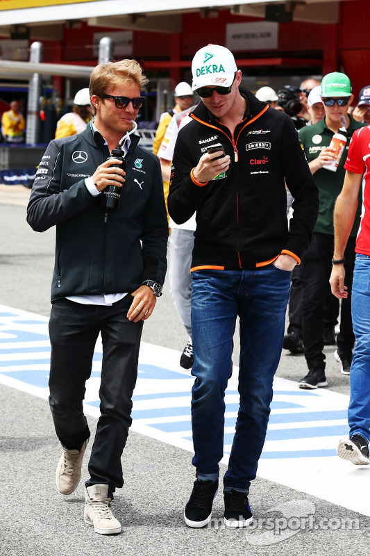 (L to R): Nico Rosberg, Mercedes AMG F1 with Nico Hulkenberg, Sahara Force India F1 on the drivers parade