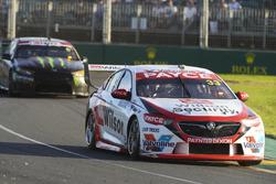 Garth Tander, Garry Rogers Motorsport Holden, leads Cameron Waters, Tickford Racing Ford