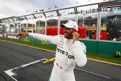 Lewis Hamilton, Mercedes AMG F1, celebrates taking pole position alongside on the pit straight
