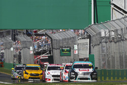 Michael Caruso, Nissan Motorsport Nissan, leads Garth Tander, Garry Rogers Motorsport Holden, and Will Davison, 23Red Racing Ford