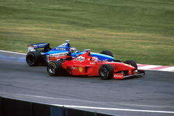 Alex Wurz, Benetton Playlife B198 attempts to overtake Eddie Irvine, Ferrari F300