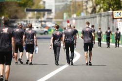 Romain Grosjean, Haas F1 Team, walks the track with his team