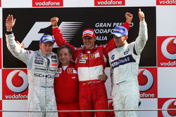 Podium: second place Kimi Raikkonen, McLaren, Jean Todt, Ferrari Sporting Director, race winner Michael Schumacher, Ferrari and third place Robert Kubica, BMW Sauber F1