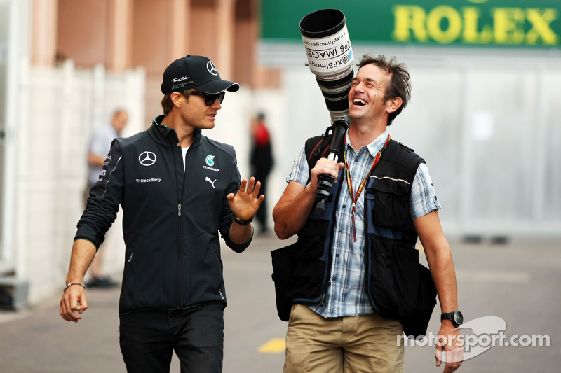 (L to R): Nico Rosberg, Mercedes AMG F1 with Russell Batchelor, XPB Images Photographer