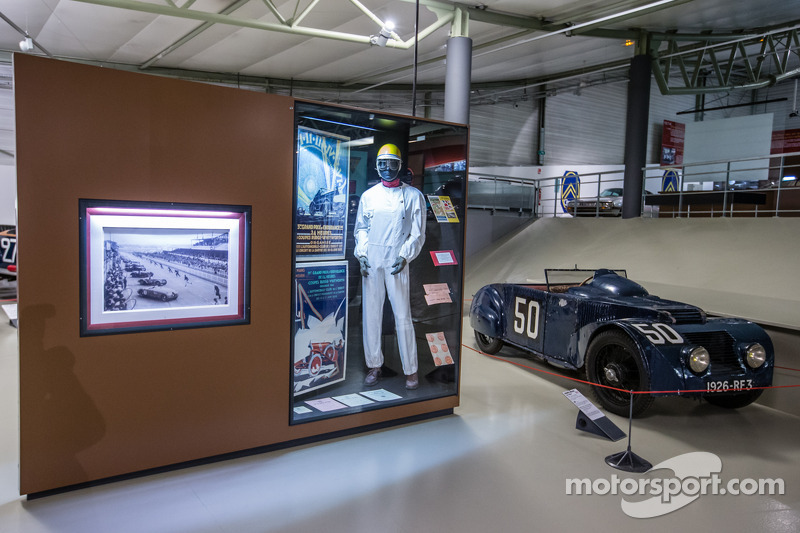 Display with vintage driver suit