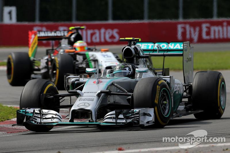 Nico Rosberg, Mercedes AMG F1 W05; Sergio Perez, Sahara Force India F1 VJM07