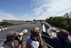 Photographers shoot at the hairpin
