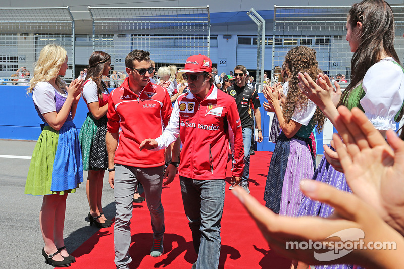 (L to R): Jules Bianchi, Marussia F1 Team with Fernando Alonso, Ferrari on the drivers parade