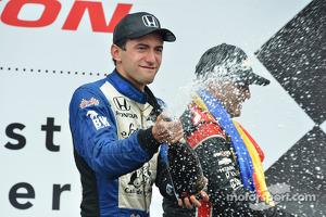Carlos Huertas celebrates his first win
