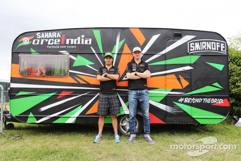 (L to R): Sergio Perez, Sahara Force India F1 and team mate Nico Hulkenberg, Sahara Force India F1 with the Sahara Force India F1 Team caravan
