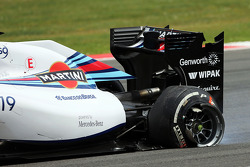 Felipe Massa, Williams FW36 with a punctured rear tyre and damaged rear suspension