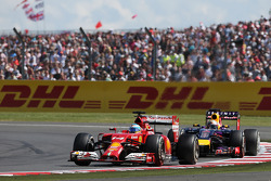 Fernando Alonso, Ferrari F14-T leads Sebastian Vettel, Red Bull Racing RB10