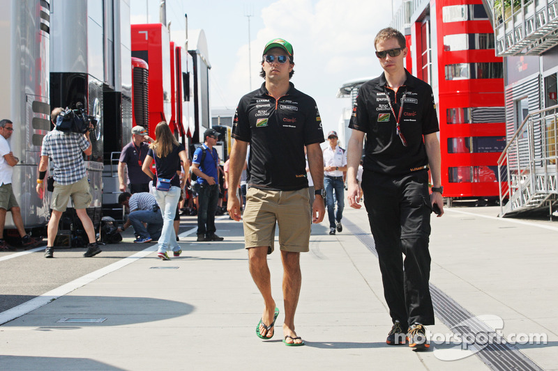 (L to R): Sergio Perez, Sahara Force India F1 with Will Hings, Sahara Force India F1 Press Officer