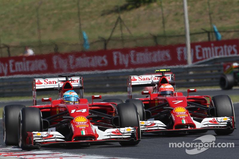 Fernando Alonso, Ferrari F14-T leads team mate Kimi Raikkonen ...