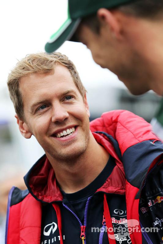 (L to R): Sebastian Vettel, Red Bull Racing with Andre Lotterer, Caterham F1 Team