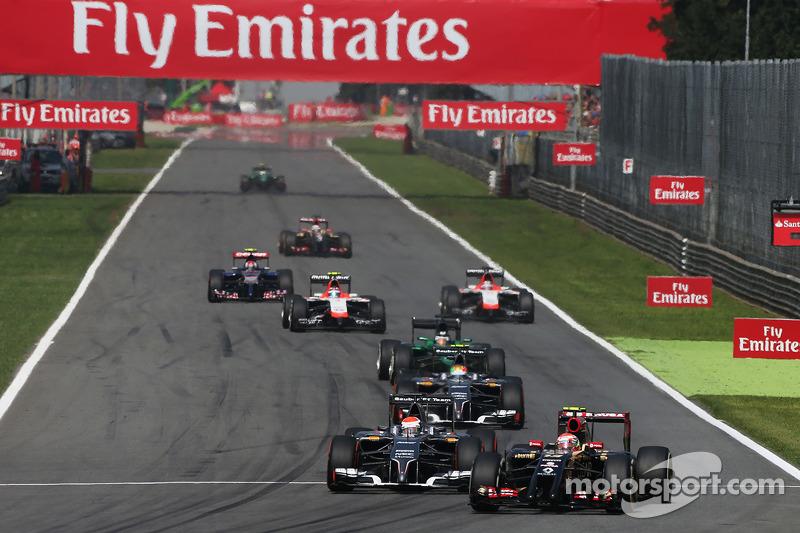 Pastor Maldonado, Lotus F1 E21 y Adrian Sutil, Sauber C33