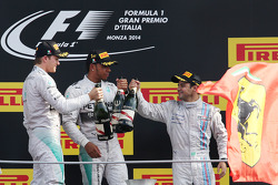 Podium: race winner Lewis Hamilton, second place Nico Rosberg, third place Felipe Massa