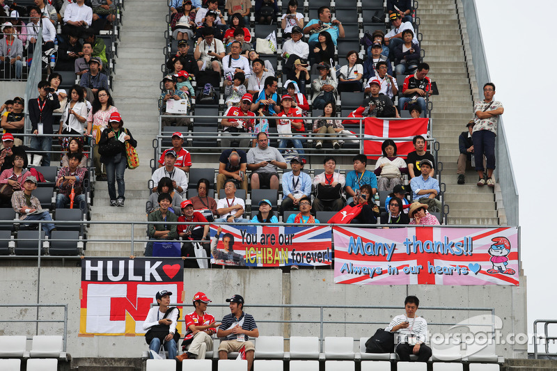 Fans in the grandstand and banners for the drivers