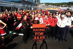 Max Chilton, Marussia F1 Team and members of the team show their support for Jules Bianchi on the grid