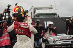 Stéphane Ortelli celebrates with race winner Laurens Vanthoor