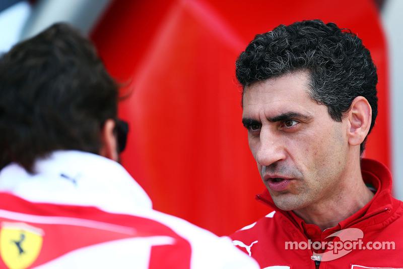 (L to R): Fernando Alonso, Ferrari with Andrea Stella, Ferrari Race Engineer