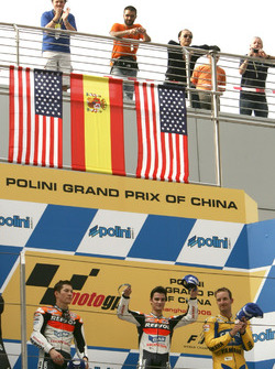 Podium: second place Nicky Hayden, Repsol Honda Team, Race winner Dani Pedrosa, Repsol Honda Team, third place Colin Edwards