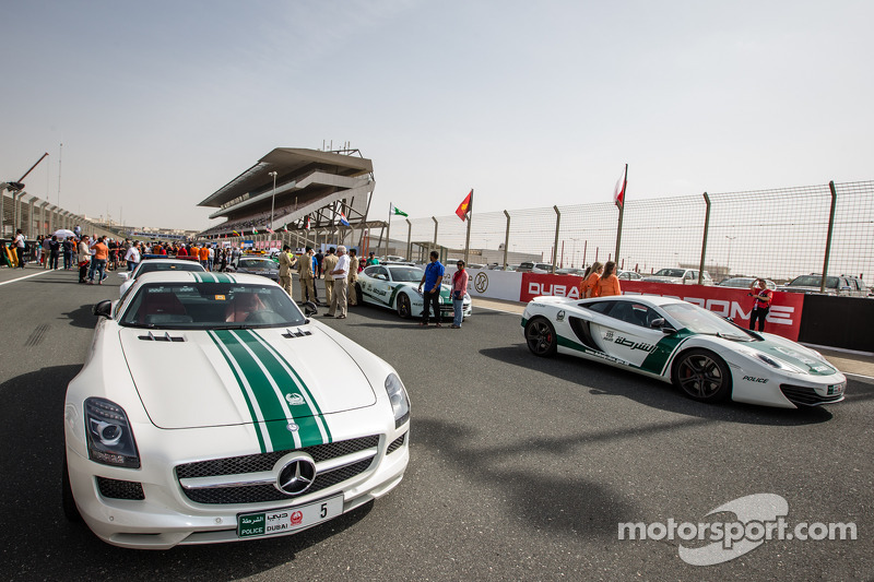 Dubai police exotic cars on display: a Mercedes AMG SLS, an Audi R8, a McLaren MP4-12C and a Ferrari FF