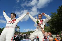 Podium: 2004 WRC champions Sébastien Loeb and Daniel Elena celebrate