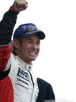 LM P1 podium: race winner Tom Kristensen celebrates