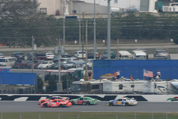 Tony Stewart takes the lead from Jeff Burton with some help from Bobby Labonte