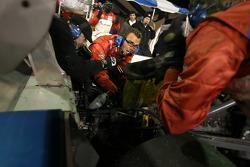 Rx.com/ Synergy Racing crew members work on the BMW Doran engine