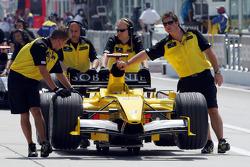 Jordan team members push the car