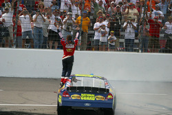 Race winner Greg Biffle celebrates in front of the grandstands