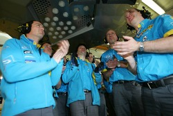 Renault F1 team members celebrate after Fernando Alonso's qualifying lap
