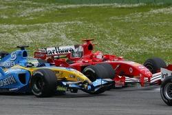 Giancarlo Fisichella battles with Michael Schumacher