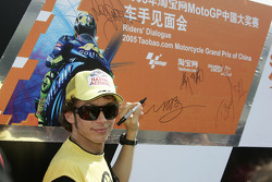 Valentino Rossi signs his name