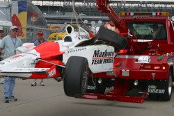 Sam Hornish Jr.'s car arrives on the wrecker after his flip on the back straight