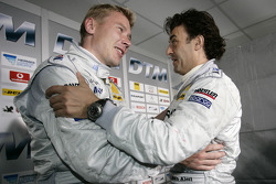 Pole winner Mika Hakkinen with Jean Alesi