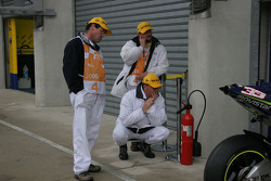 Course marshals watch garage activity