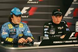 Press conference: provisional pole winner Kimi Raikkonen with Fernando Alonso
