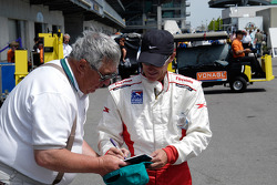 Tom Wood signs an autograph
