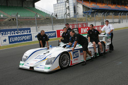 Champion Audi team members push car to scrutineering