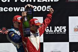 Paul Tracy and Cristiano da Matta celebrate
