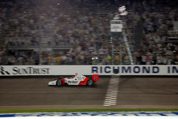 Helio Castroneves takes the checkered flag