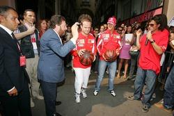 Vodafone race event in Milan: Rubens Barrichello and Michael Schumacher play basketball