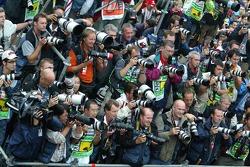 Photographers get ready to shoot the podium ceremony